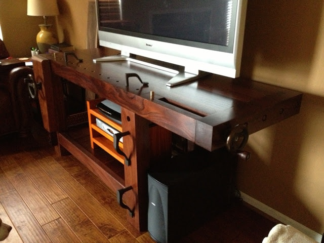 Beautiful mahogany woodworking Roubo Bench as a TV stand.
