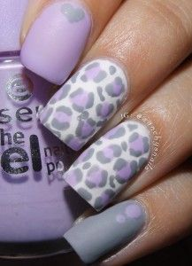 Lavender themed leopard nail art design. The cute and subtle lavender color makes the leopard prints look almost laid back and beautiful. It also blends well with the white background and black outlines.