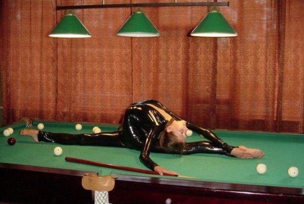 Plastic girl plays billiard