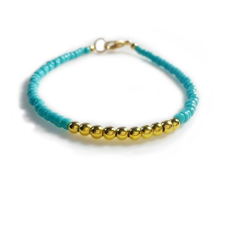 This wonderful friendship bracelet is made with turquoise and gold beads. A beautiful and timeless color combination looks great so that this bracelet can be stacked with other beaded bracelets for a