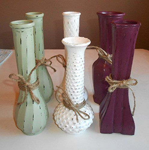 Upcycled Vintage, Milk Glass, Clear Glass, Bud Vases, Distressed Vases, Green, Plum, White, Jute Embellished, Hand Painted. Six vintage glass vases distressed in milk white, sage green, and plum satin; embellished with jute bow; hand painted on exterior; clean with damp cloth dubbing motion; can hold water for fresh flowers; nice grouping for centerpieces for weddings, anniversaries and most social affairs, shabby chic, cottage chic, primitive look; sealed with protective coating.