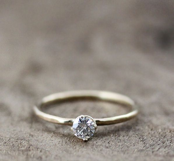 Thin round band with slightly hammered finish and diamond in 4 prong setting - andrea bonelli
