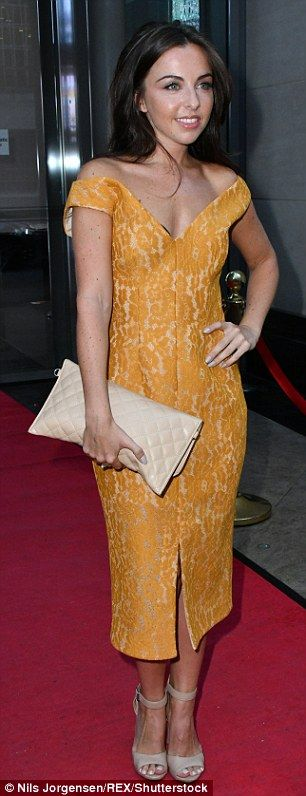 Golden girl: Louisa Lytton opted for a low-cut golden number...