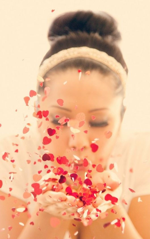 Heart-shaped wedding confetti. The colour really adds something to the photies!
