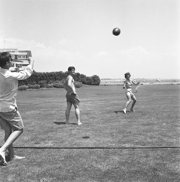 John F. Kennedy and Jacqueline Kennedy playing football on the grounds of the Kennedy compound, June 1953.