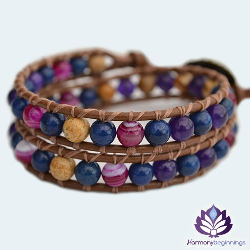 OurEndlesswrap bracelet has been designed witha combination of deep purple Amethyst, Pink Stripe Agate, Picture Jasper and Lapis Lazuli Gemstones. The natural properties of these stones work harmoniously with our energies to bring balance, strengthen our love relationships and heighten our spiritual awareness.  Onbrown genuine leather (or vegan alternative*), finished with a uniquebronze button clasp.Can be purchased in two optional sizes ...
