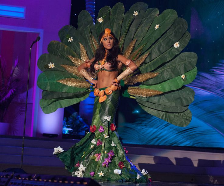 Brittany Bell looks to the side as she dons a tree costume for her look.