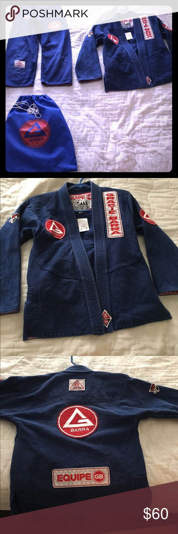 Gracie Barra Jiujitsu Gi (Youth Size 5) Gracie Barra Jiujitsu Gi (Youth Size 5)  in Blue. Worn but lots of life left. No rips or tears just discolored from washing. My son outgrew this too fast. Gracie Barra Other