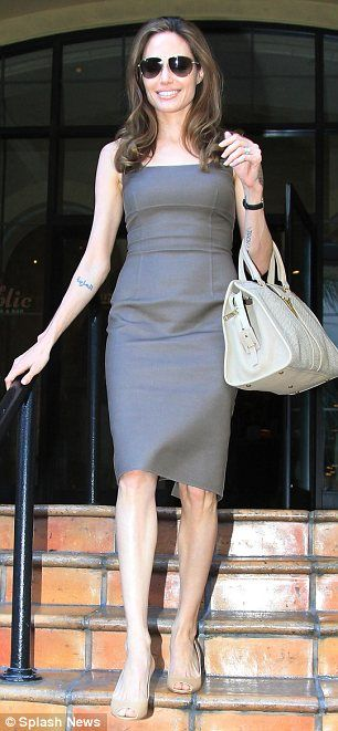 Angelina Jolie showing off her ginormous engagement ring. She's getting married to some actor called Brad Pitt.