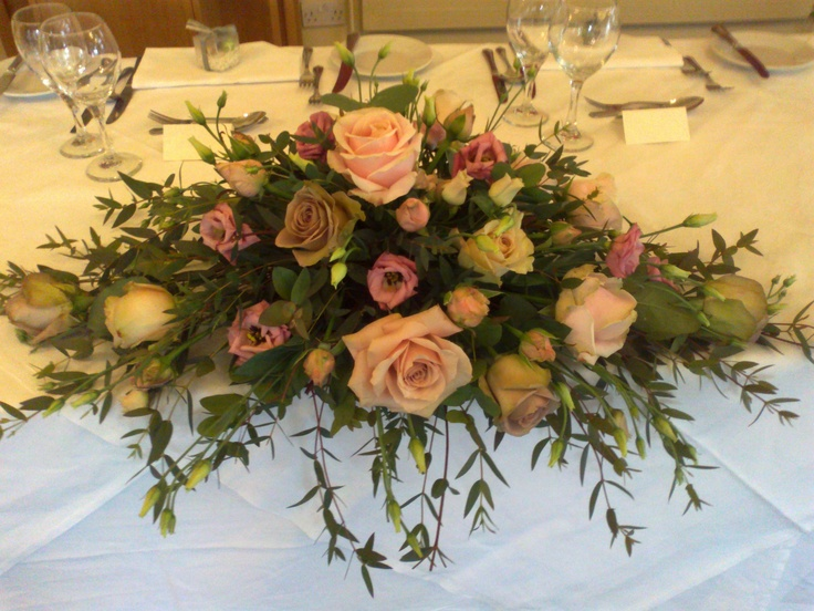 Top table wedding flowers in vintage muted tones. BY Fleur Couture Floral Design