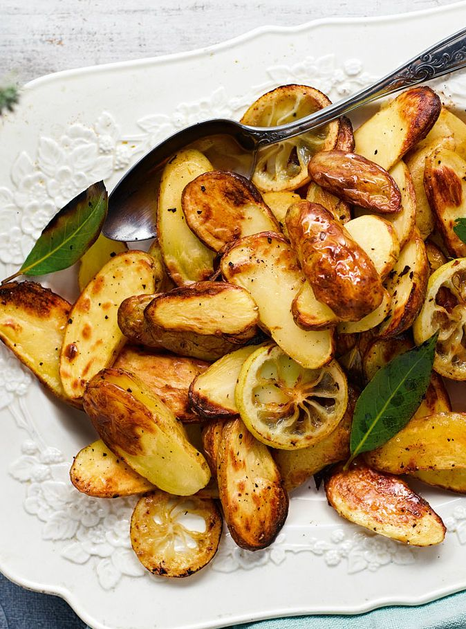A tasty twist on classic roast potatoes. The lemon and bay leaves add an exciting flavour that is really delicious when paired with a seafood-based main. | Tesco