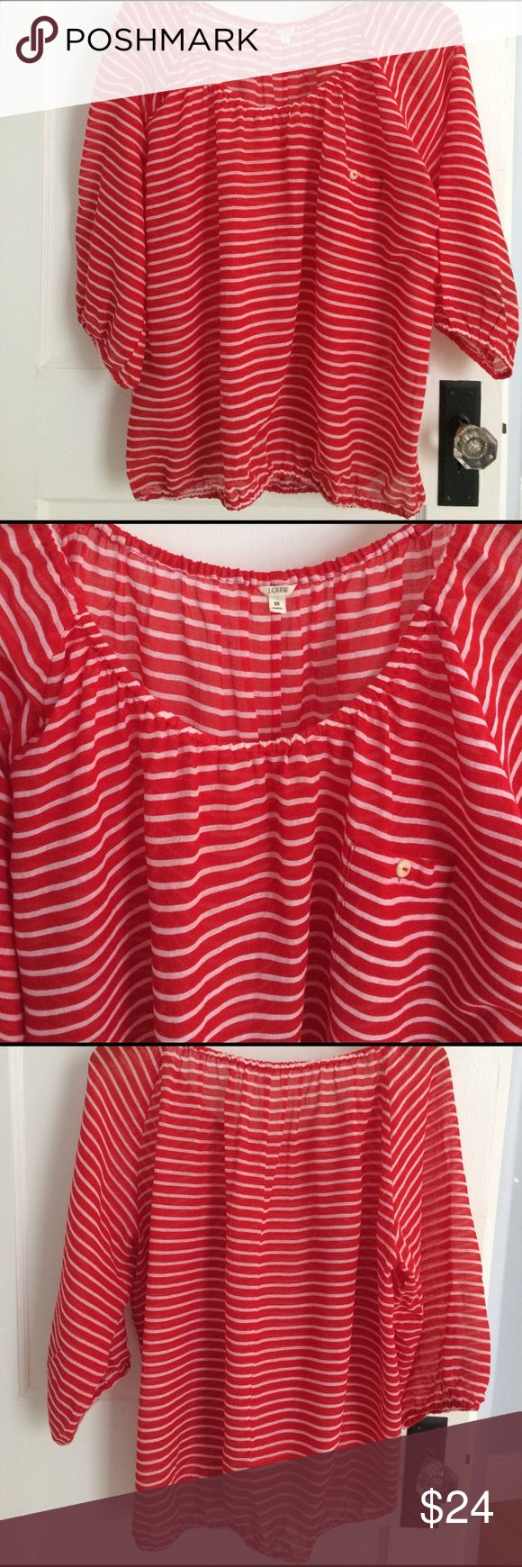 J.Crew Blouse Fresh, summer red stripe popover from J.Crew. Breezy, light weight cotton with elasticized cuffs and bottom. It is a bit sheer, so you might be most comfortable wearing with a tank. Still able to wear with just a nude bra. There is one tiny snag (as shown in photo) and some seam slippage on both bottom sides. Barely noticeable when wearing. Smoke free home, no trades. Color for sale is red/white, shown in navy/white for silo. J. Crew Tops