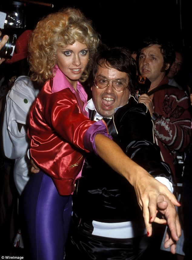 U.S. Singer Olivia Newton-John and producer Allan Carr attend the 'Grease' Premiere Party on June 13, 1978 at Studio 54, NYC.