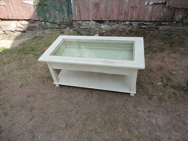 glass top display coffee table -- souvenir collections could go