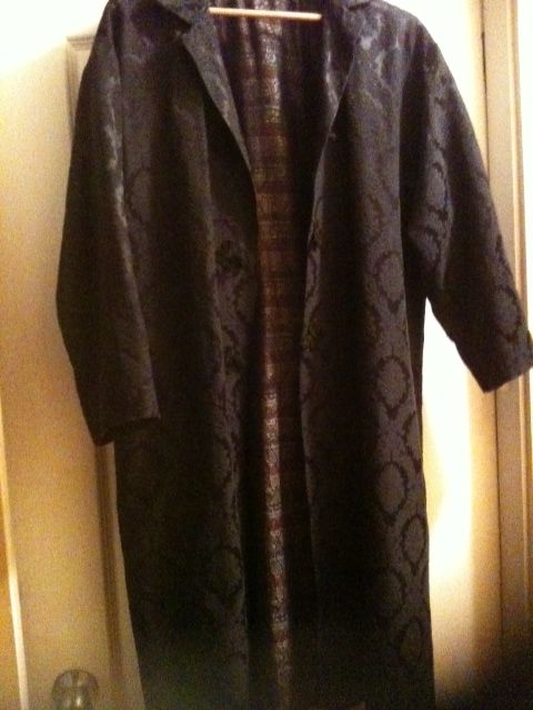 Black 3/4 length brocade coat with satin paisley lining. Talize, $7.50.