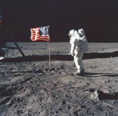 Neil Armstrong - first man on the moon, planting the flag of