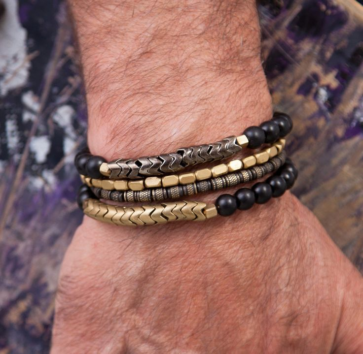 FREE SHIPPING! (US)  Mens Chumash Black & Brass Bracelet  Black wood bead bracelet with contemporary brass snake beads from Thailand  Handmade in Santa Barbara, California  Approximate Inner Circumference (in inches):7    $ 13.00 from this purchase will go to the cause of your choice