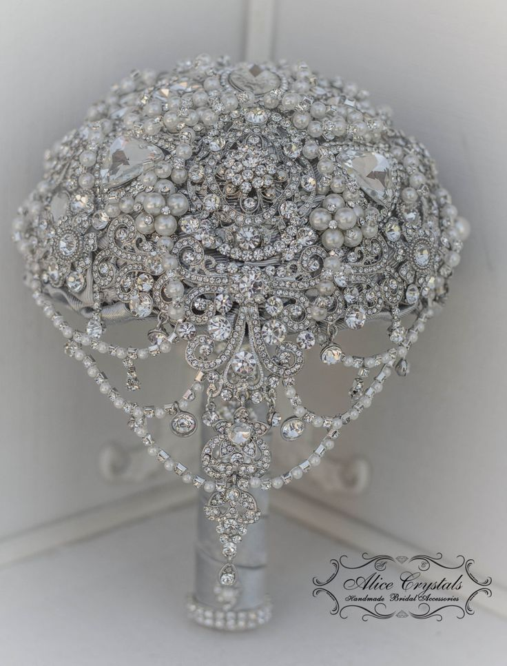 Pearl Brooch Bouquet. The Great Gatsby Brooch Bouquet. Cascading jeweled crystal bouquet silver. by AliceCrystals on Etsy https://www.etsy.com/listing/233492857/pearl-brooch-bouquet-the-great-gatsby
