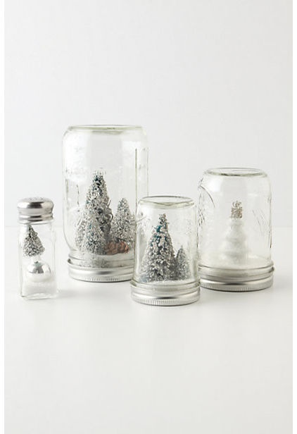 Simple and creative DIY gifts like these mason jar snow globes do double duty as whimsical centerpieces and charming keepsakes.