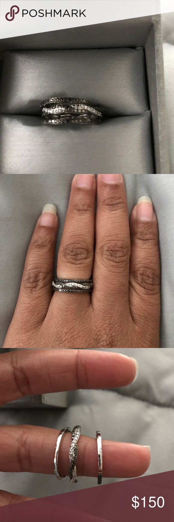 Black diamonds three band ring Silver and black diamonds three band ring. Brand new. Never worn. Purchased another ring instead. Zales Jewelry Rings