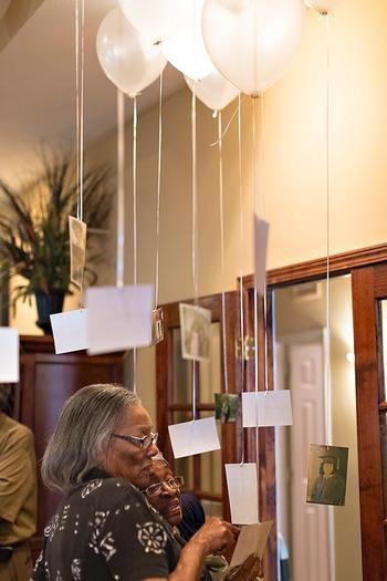 Photo display idea: hung from balloons
