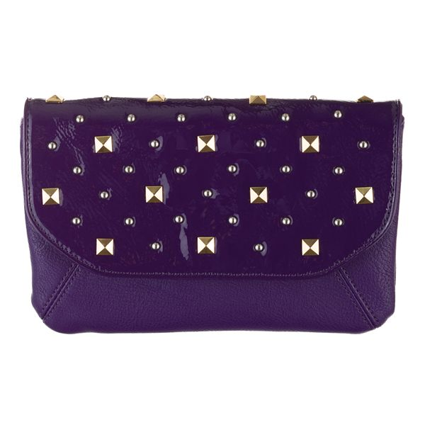 """Faith-Grape Clutch Why choose silver or gold when you can rock both? Add a little edge to your look with this multi-tone clutch — these pyramid-shaped studs say """"style."""" Slip it in the front pocket of your favorite Grace Adele Bag to create a look that's all your own. • Faux leather • 9"""" L, 6"""" H • Detachable strap with 22"""" drop • Button closure"""