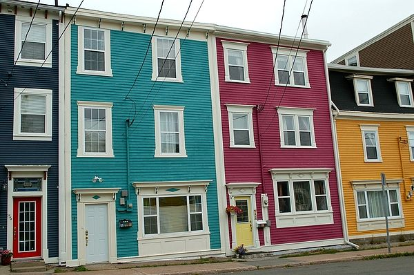 """The downtown of St. John's, Newfoundland is renowned for its brightly coloured Victorian rowhouses. Because of their vibrant colours, the houses are known affectionately as """"Jellybean Row""""."""