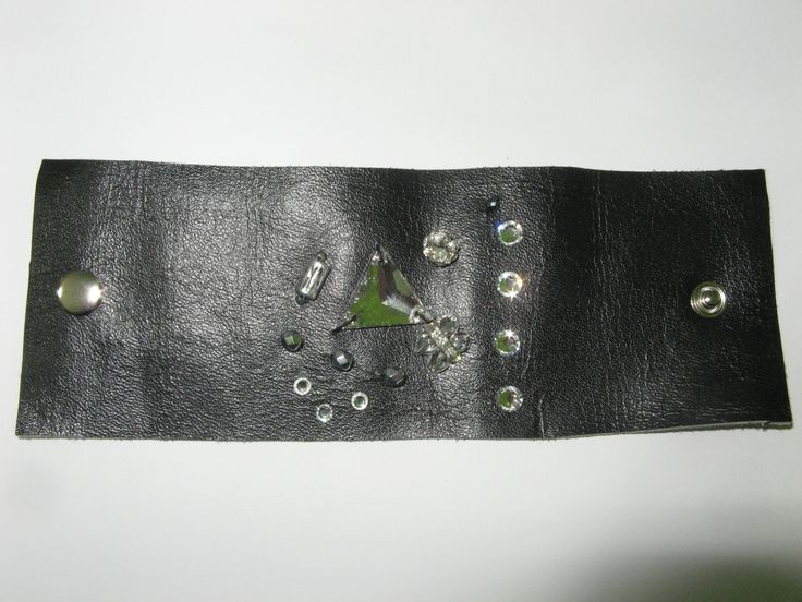 Leather cuff (1 pc)  Made with black leather, swarovski crystals, glass beads and metals with transparent crystals.