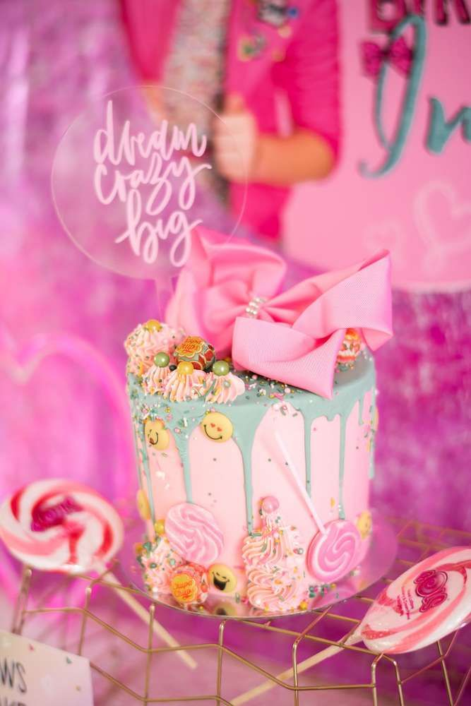 Wow!! The birthday cake at this JoJo Siwa Birthday Party is amazing!! See more party ideas and share yours at CatchMyParty.com #catchmyparty #birthdaycake #girlbirthdayparty #emojiparty