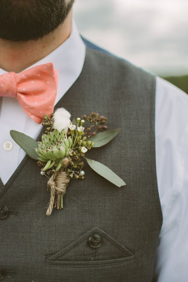 succulent and seeded eucalyptus boutonniere, photo by Hot Metal Studio http://ruffledblog.com/white-barn-wedding #groom