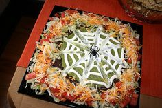 I like this spooky version of seven layer dip...always a party hit.