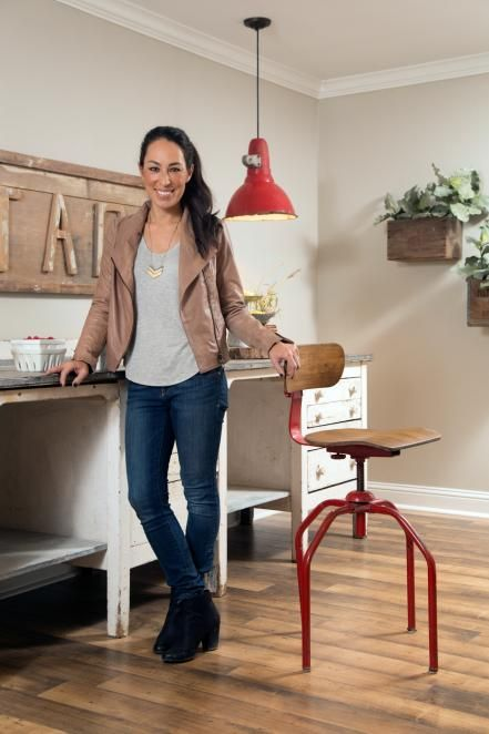 Joanna stands in the new dining room that she furnished with vintage pieces and decorated in a casual, outdoorsy style.