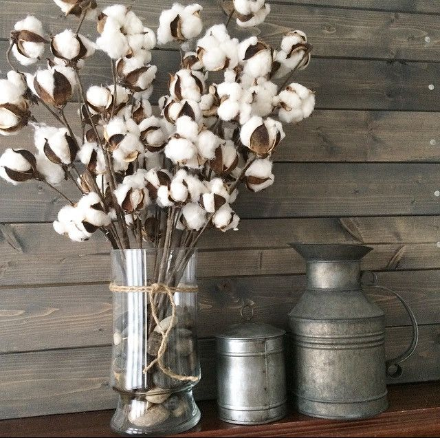 "Set of 4 Cotton Picks -  Bring a rustic accent to your farmhouse with this Cotton Pod Stem and add a touch of country-chic charm to your decor. Bundle by itself in a tall vase, or arrange with bouquets of faux wildflowers or golden stalks of wheat. Each stem has 10 actual cotton pods wired to paper wrapped stems. About 20"" high. Sold as a set of 4 stems."