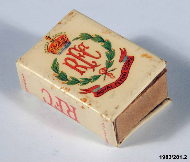 Royal Flying Corps matchbox holder, World War One era. This metal holder is decorated with the RFC badge with wreath and King's Crown, and RFC pilot's wings. From the collection of the Air Force Museum of New Zealand.