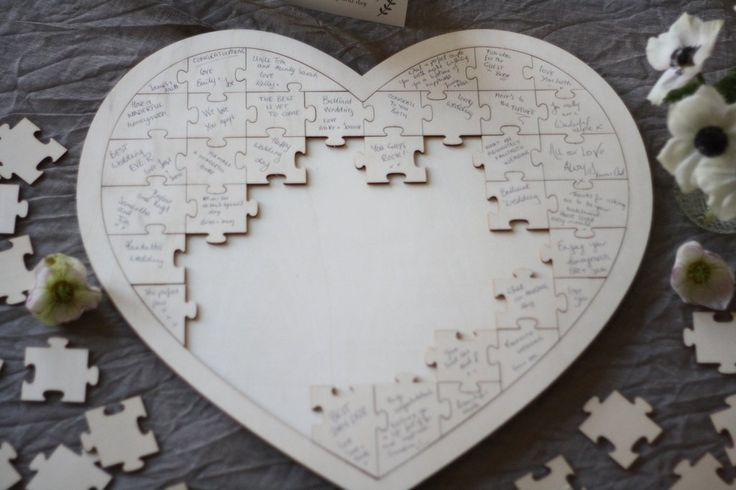 For an alternative to a traditional wedding guest book we love this jigsaw puzzle.  The jigsaw puzzle wedding guest book is heart shaped and made from wood. Guests can write their kind words on a puzzle piece and then place the pieces of the puzzle together.  The puzzle comes with a card explaining to guests what to do. It reads; Dear family and friends, please help keep this memory by signing a puzzle piece and adding it to the heart. Thank you so much for sharing part of this special day. …