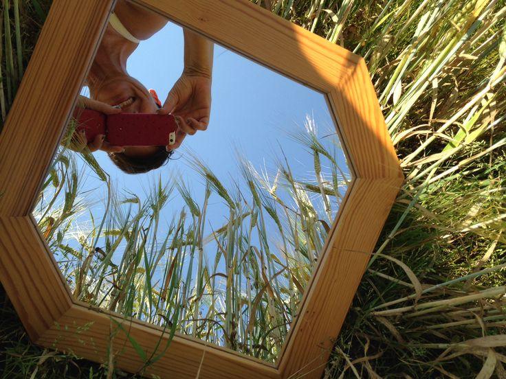 Selfie in a mirror in the fields in Sweden