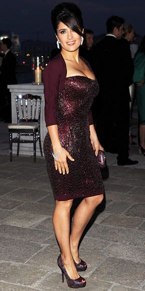 Salma Hayek made an entrance at the Il Mondo Vi Appartiene dinner in a beaded Gucci cocktail sheath, snakeskin minaudiere and peep-toe heels.
