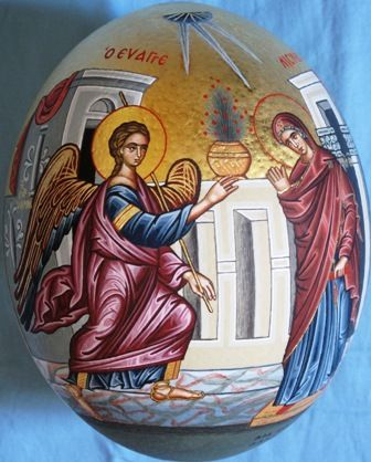 Hand painted icon of Annunciation on ostrich egg with eggyolk tempera colours and real gold sheets on background.