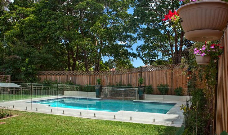 glass fencing on swiming pool | crystal pools australia s most experienced swimming pool builder
