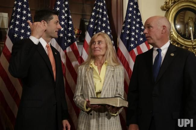 House Speaker Paul Ryan (R-WI) (L) talks to Rep.-elect Greg Gianforte as his wife Susan after a ceremonial swearing-in on Capitol Hill in…
