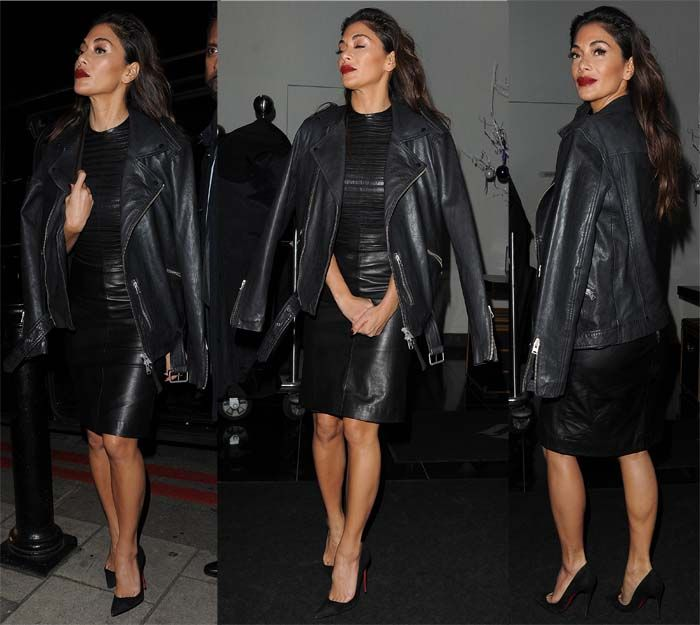 Nicole Scherzinger steps out of her hotel in a knee-length leather dress with matching leather jacket on December 3, 2016