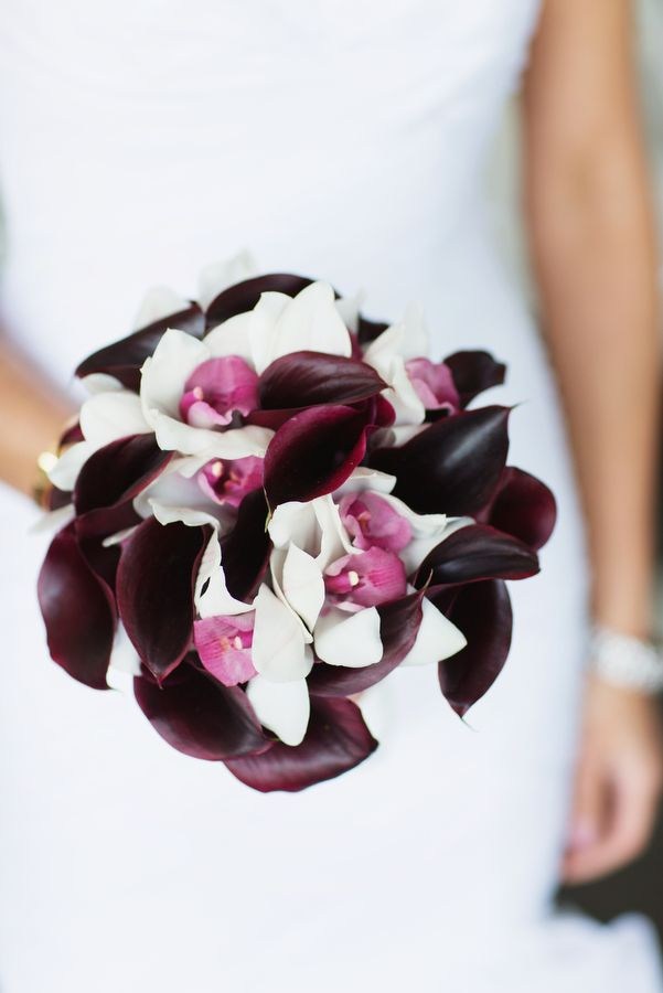 Purple wedding bouquet featuring orchids and calla lilies {Photo by Jonathan Young Weddings via Project Wedding}