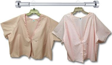 Mammography gowns are available in heavyweight and feminine rosebud print, solid rose or pink. The kimono style, front opening gown, is knee length or hip length. #towels #mammography #mammographygowns #gowns #mammographycapes