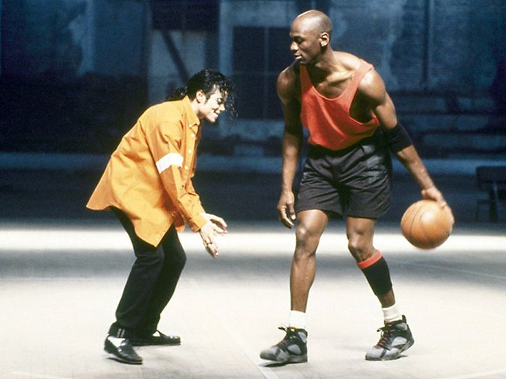 Michael Jackson playing a little one-on-one with Michael Jordan. The King of Pop vs. the King of Hoops.
