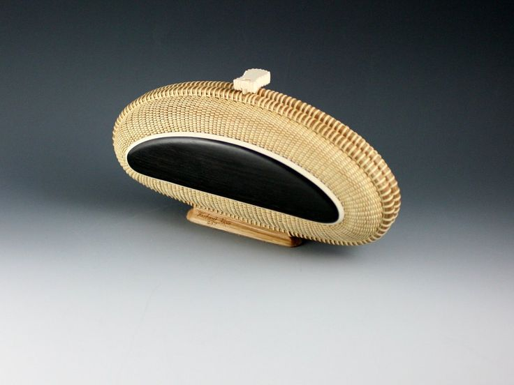 This beautiful clutch Nantucket Basket is by Michael and has ebony and ivory top on this side the other is ivory and ebony.