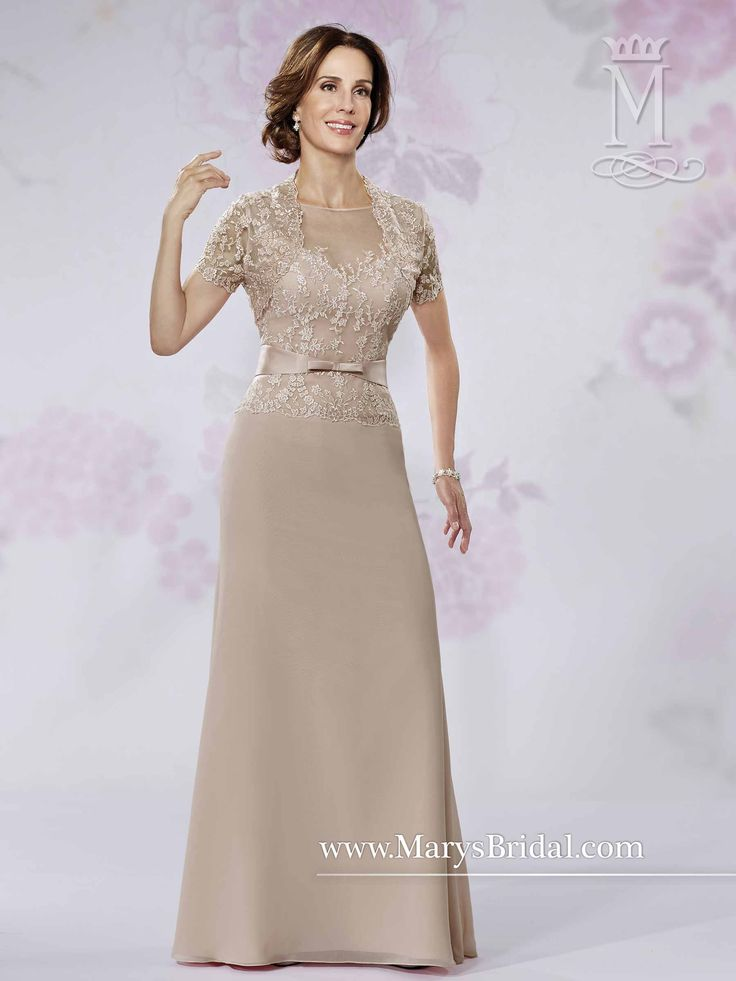 A-line mother-of-the-bride gown featuring sheer bateau neckline, sheer upper back with keyhole, lace bodice, satin bow belt, chiffon skirt, and a short sleeve lace bolero.