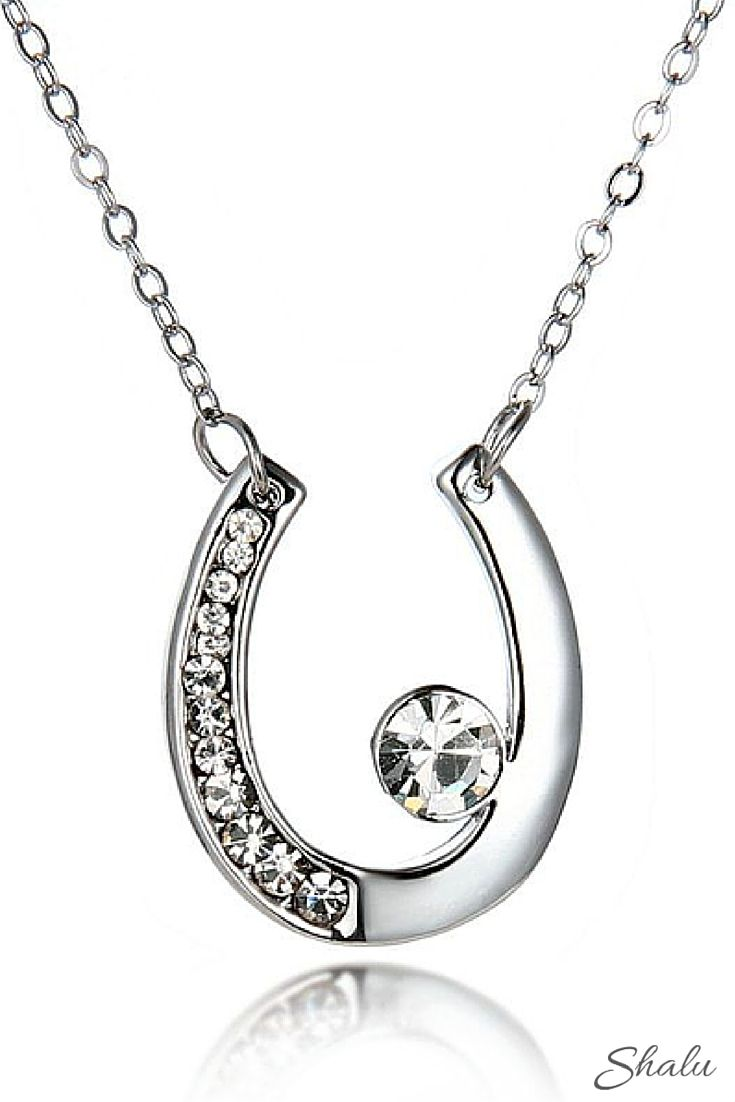 Create more sparkle in your life with this silver plated horse shoe necklace featuring 13 sparkling accents.Definitely a must-have lucky charm for horse lovers.