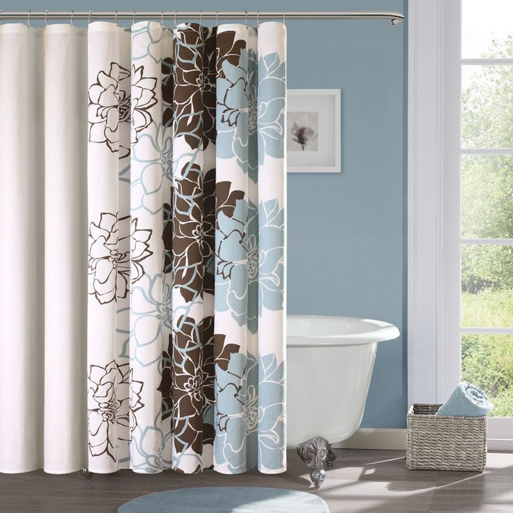 Update your bathroom with this lovely floral cotton shower curtain from Madison Park. The Farrah shower curtain's design uses a soft blue-and-brown palette for a modern look. The 100 percent cotton fabric has a slight sheen to it that catches the eye.
