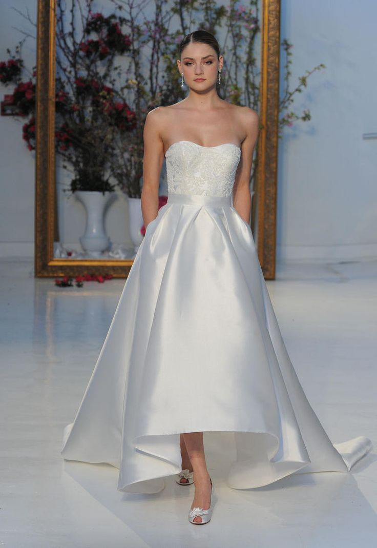 Satin high-low gown with strapless neckline | Anne Barge Spring 2017 | https://www.theknot.com/content/anne-barge-wedding-dresses-bridal-fashion-week-spring-2017