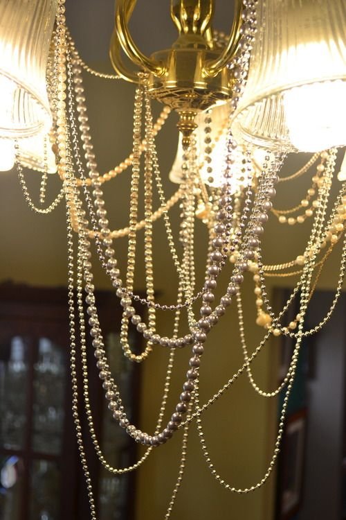 "Wei's ""Breakfast at Tiffany's"" Bridal Shower - pearls were draped over the chandelier for added oomph"